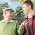 Senior man and adult grandson in park